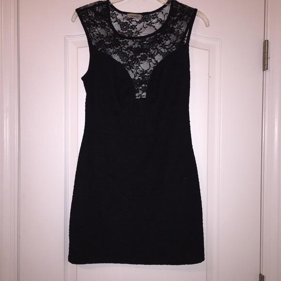 Dresses & Skirts - Lace cut out little black dress